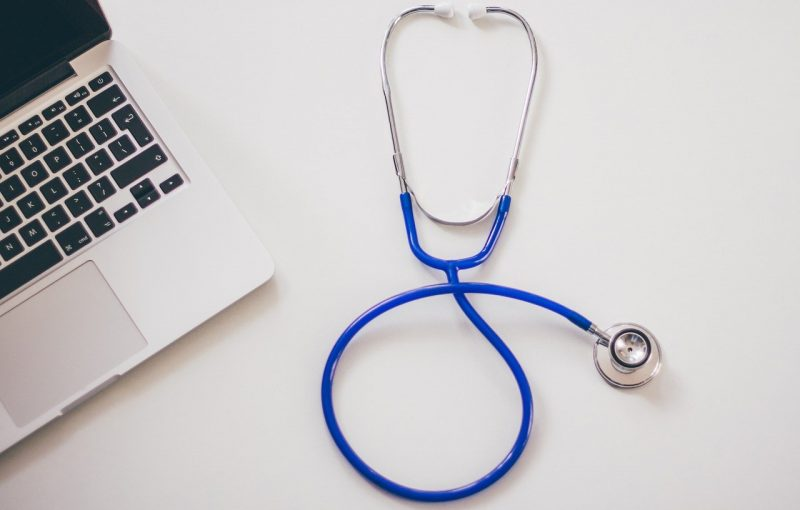 stethoscope next to laptop