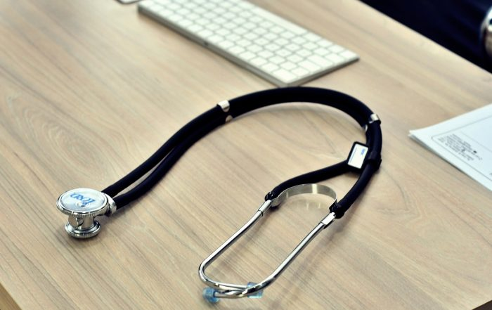 stethoscope on top of desk in medical office